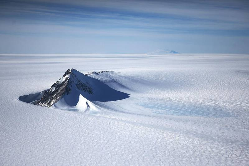 ANTARCTICA - OCTOBER 28:  A section of the West Antarctic Ice Sheet with mountains is viewed from a window of a NASA Operation IceBridge airplane on October 28, 2016 in-flight over Antarctica. NASA's Operation IceBridge has been studying how polar ice has evolved over the past eight years and is currently flying a set of 12-hour research flights over West Antarctica at the start of the melt season. Researchers have used the IceBridge data to observe that the West Antarctic Ice Sheet may be in a state of irreversible decline directly contributing to rising sea levels. NASA and University of California, Irvine (UCI) researchers have recently detected the speediest ongoing Western Antarctica glacial retreat rates ever observed. The United Nations climate change talks begin November 7 in the Moroccan city of Marrakech.  (Photo by Mario Tama/Getty Images)