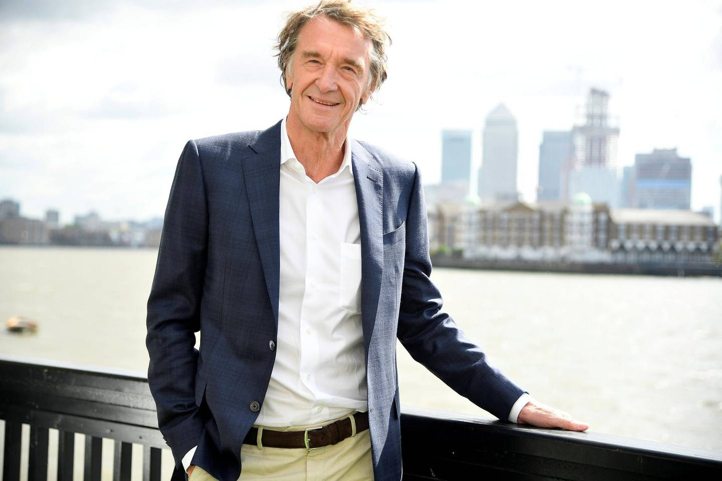 Jim Ratcliffe, CEO of British petrochemicals company INEOS, poses for a portrait with the Canary Wharf financial district seen behind, ahead of a news conference announcing the launch of a British America's Cup sailing team in London, Britain, April 26, 2018. REUTERS/Toby Melville