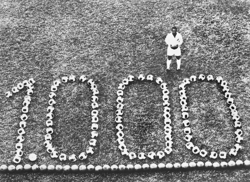 BRAZIL - DECEMBER 12:  PELE, the famous Brazilian football player celebrating his 1000th goal in front of the triumphant number formed by footballs.  (Photo by Keystone-France/Gamma-Keystone via Getty Images)