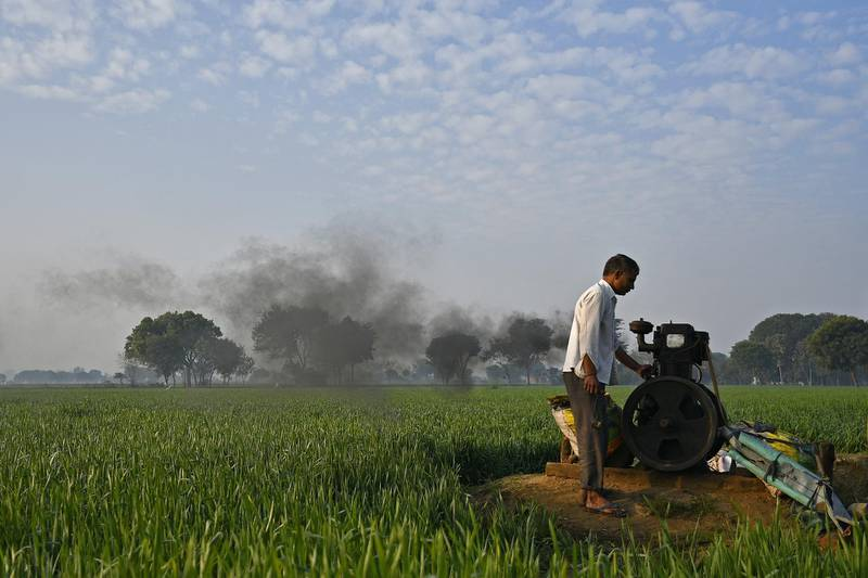 A man turns on a water pump at a farm in Palwal district, Haryana, India, on Friday, Jan. 12, 2018. Time is running out for India's Prime Minister Narendra Modi to shore up the support of rural voters who underpinned his rise to power in 2014, when he won India's biggest mandate in three decades. The budget on Feb. 1 will be the last opportunity for him to announce significant fiscal measures that could win back villagers. Photographer: Anindito Mukherjee/Bloomberg