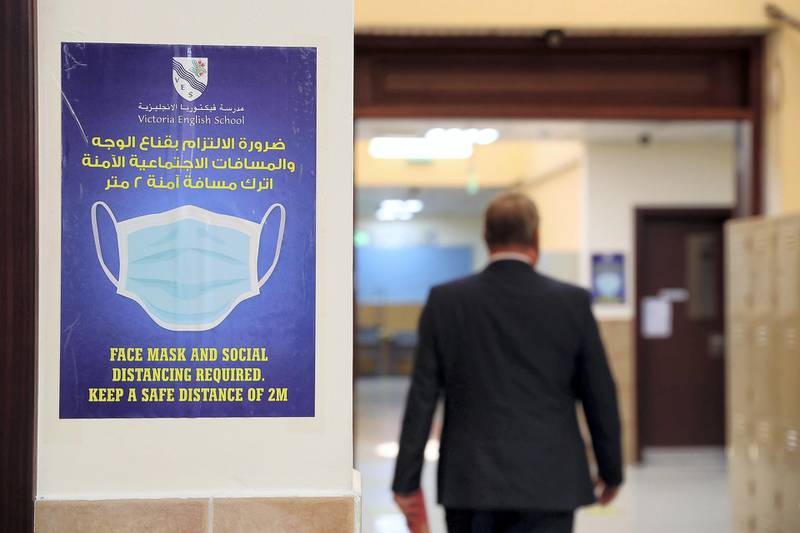 SHARJAH, UNITED ARAB EMIRATES , September 24 – 2020 :- Face mask signs pasted on the walls at the Victoria English School in Sharjah. Schools in Sharjah are opening on 27th September.  (Pawan Singh / The National) For News. Story by Salam