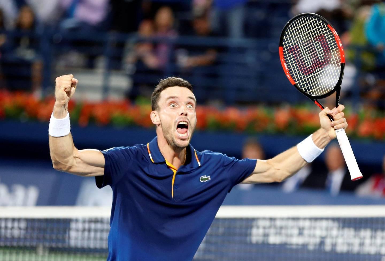 Tennis - ATP - Dubai Open - Final - Dubai, United Arab Emirates - March 3, 2018. Roberto Bautista Agut of Spain celebrates after defeating Lucas Pouille of France. REUTERS/Ahmed Jadallah