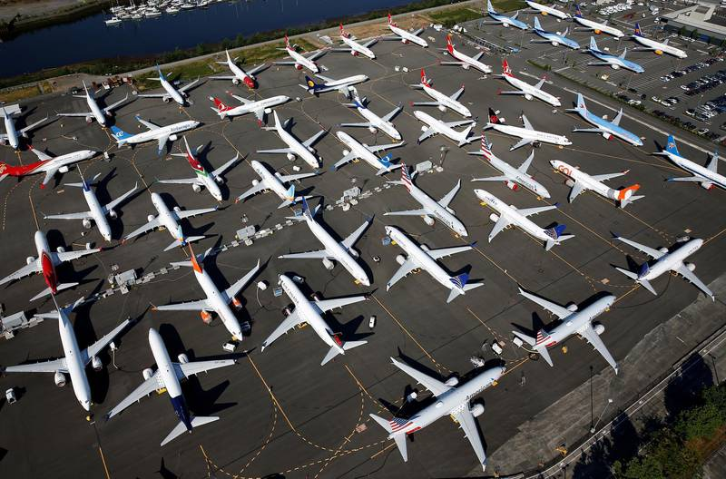 FILE PHOTO: Dozens of grounded Boeing 737 MAX aircraft are seen parked in an aerial photo at Boeing Field in Seattle, Washington, U.S. July 1, 2019. Picture taken July 1, 2019.  REUTERS/Lindsey Wasson/File Photo