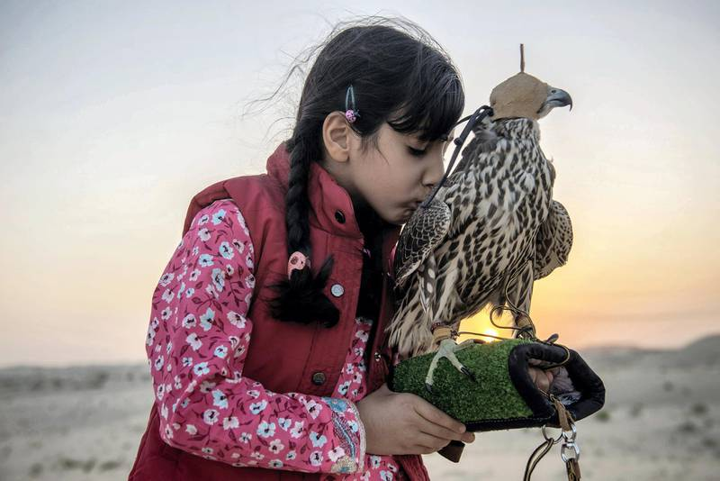 Osha Khaleefa Al Mansoori (7),  she is very much confident and passionate about falcons and falconry as a heritage sport, before release the falcon for the training , she always embrace her falcon at remote Abu Dhabi desert, UAE, Vidhyaa Chandramohan for The National