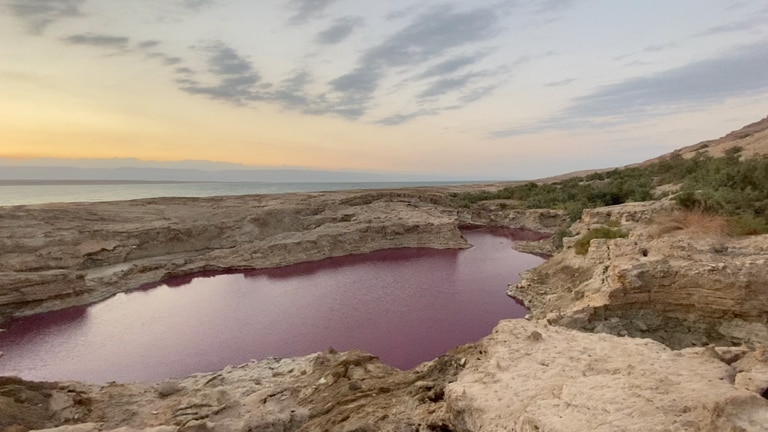 An image that illustrates this article What is the story behind the red lake by Jordan's Dead Sea?