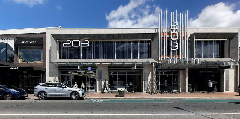The same location in Redcliffs suburb of Christchurch nearly 10 years later where new retail buildings occupy the site on February 17, 2021. AFP