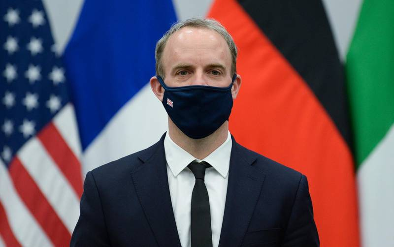 epa09135452 Britain's Foreign Secretary Dominic Raab wears a protective mask during a meeting with U.S. Secretary of State Antony Blinken in Brussels, Belgium, 14 April 2021. Blinken briefed NATO partners on the US plans to withdraw its troops from Afghanistan.  EPA/JOHANNA GERON / POOL