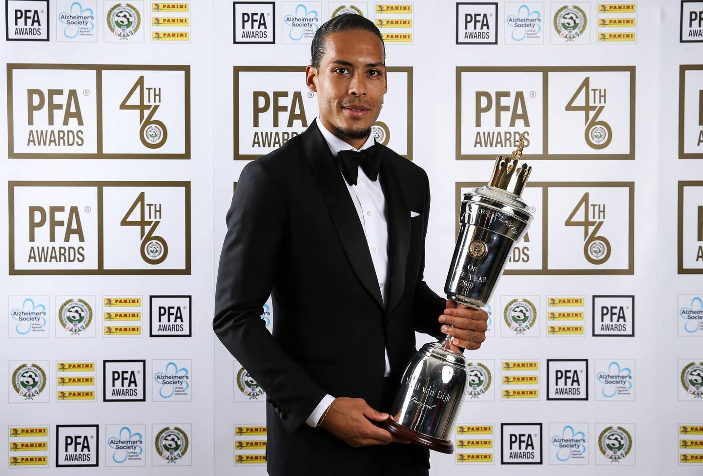 Liverpool's Virgil van Dijk poses with his PFA Player of the Year award during the 2019 PFA Awards at the Grosvenor House Hotel, London. PRESS ASSOCIATION Photo. Picture date: Sunday April 28, 2019. See PA story SOCCER PFA. Photo credit should read: Barrington Coombs/PA Wire