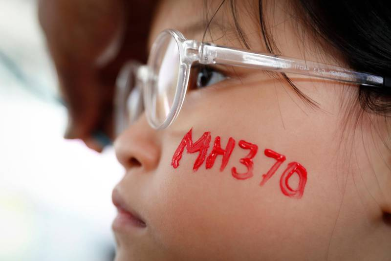 """In this photo taken March 3, 2018, a girl has her face painted during the Day of Remembrance for MH370 event in Kuala Lumpur, Malaysia. New Transport Minister Anthony Loke says the search for missing Malaysia Airline Flight 370 ends next Tuesday after a 90-day period under a """"no cure no fee"""" agreement with a private U.S. firm. (AP Photo/Vincent Thian)"""