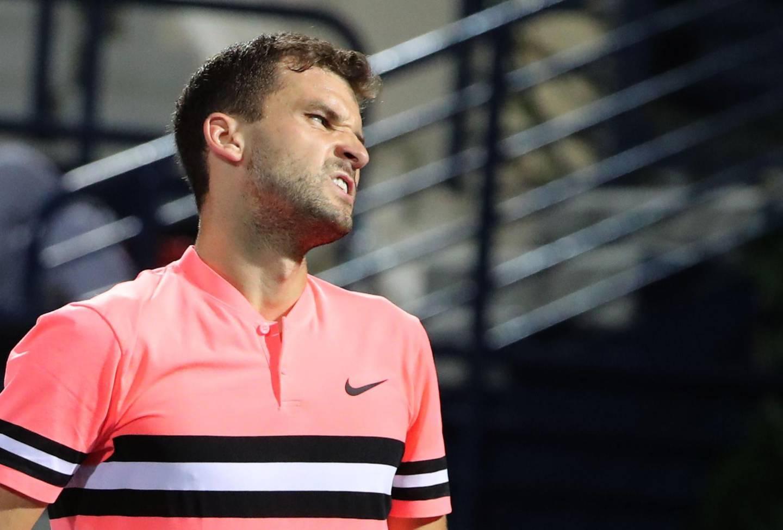 Grigor Dimitrov of Bulgaria reacts during his Dubai Duty Free Tennis singles match against Tunisia's Malek Jaziri (unseen) on February 27, 2018. / AFP PHOTO / KARIM SAHIB