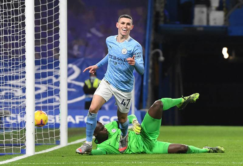 File photo dated 3-01-2021 of Manchester City's Phil Foden celebrates scoring his side's second goal of the game. Issue date: Tuesday May 11, 2021. PA Photo. Manchester City have clinched their third Premier League title in four years, PA news agency looks at five games crucial to their success. Chelsea, won 3-1, Stamford Bridge. See PA Story SOCCER Man City Games. Photo credit should read: Andy Rain/PA Wire