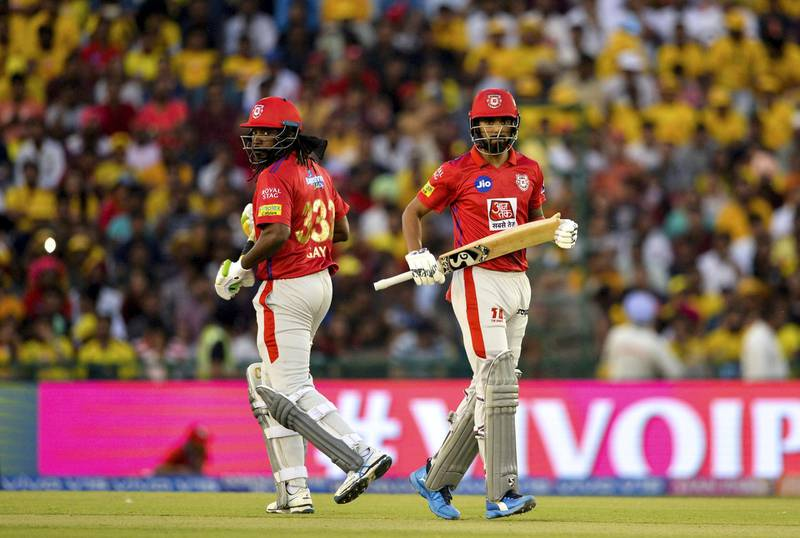 Kings XI Punjab cricketer Chris Gayle (L) and KL Rahul run between the wickets during the 2019 Indian Premier League (IPL) Twenty20 cricket match between Kings XI Punjab and Chennai Super Kings at the Punjab Cricket Association Stadium in Mohali on May 5, 2019. (Photo by Sajjad HUSSAIN / AFP) / ----IMAGE RESTRICTED TO EDITORIAL USE - STRICTLY NO COMMERCIAL USE-----