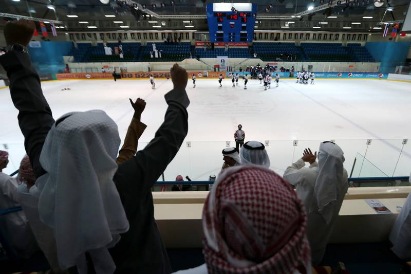 Abu Dhabi, United Arab Emirates, March 17, 2014:      UAE supporters celebrate Saeed Al Nuaimi, not pictured, scoring the winning goal in overtime against Thailand during their Challenge Cup Cup of Asia game at the Zayed Sports City Ice Rink in Abu Dhabi on March 17, 2014. Christopher Pike / The National  Reporter: Amith Passela Section: Sport