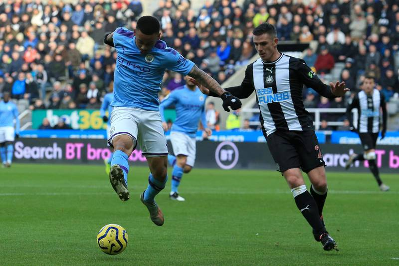 Manchester City's Brazilian striker Gabriel Jesus (L) vies with Newcastle United's Irish defender Ciaran Clark during the English Premier League football match between Newcastle United and Manchester City at St James' Park in Newcastle-upon-Tyne, north east England on November 30, 2019. (Photo by Lindsey Parnaby / AFP) / RESTRICTED TO EDITORIAL USE. No use with unauthorized audio, video, data, fixture lists, club/league logos or 'live' services. Online in-match use limited to 120 images. An additional 40 images may be used in extra time. No video emulation. Social media in-match use limited to 120 images. An additional 40 images may be used in extra time. No use in betting publications, games or single club/league/player publications. /
