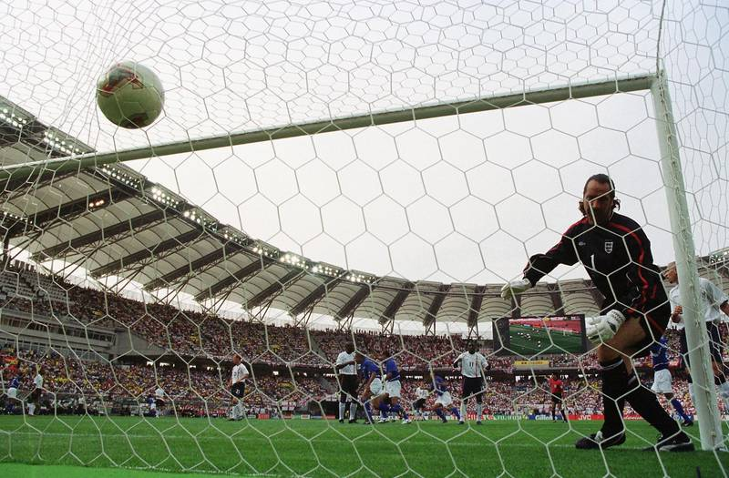 SHIZUOKA - JUNE 21:  David Seaman of England can only watch in horror as an amazing free-kick from Ronaldinho of Brazil goes in to the net for the winning goal during the FIFA World Cup Finals 2002 Quarter Finals match played at the Shizuoka Stadium Ecopa, in Shizuoka, Japan on June 21, 2002. David Seaman, who was capped 75 times for England, announced his decision to retire January 13, 2004 due to a long-term shoulder injury. (Photo by David Cannon/Getty Images)