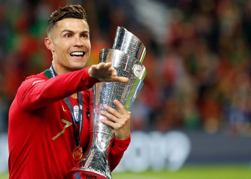 Portugal's Cristiano Ronaldo gestures as he holds the trophy after defeating the Netherlands 1-0 in the UEFA Nations League final soccer match at the Dragao stadium in Porto, Portugal, Sunday, June 9, 2019. (AP Photo/Armando Franca)
