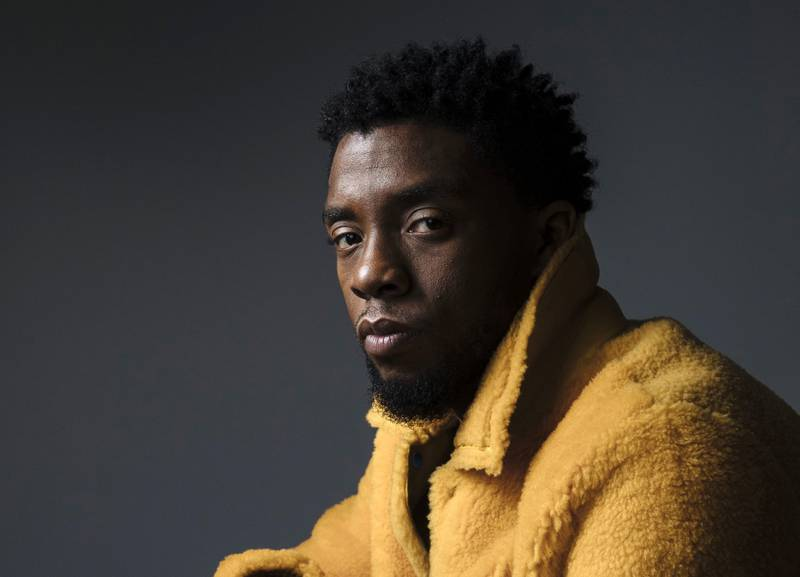 """FILE - In this Feb. 14, 2018 photo, actor Chadwick Boseman poses for a portrait in New York to promote his film, """"Black Panther."""" Boseman, who played Black icons Jackie Robinson and James Brown before finding fame as the Black Panther in the Marvel cinematic universe, died of cancer at the age of 43 on Friday, Aug. 28, 2020, his representative said. (Photo by Victoria Will/Invision/AP, File)"""