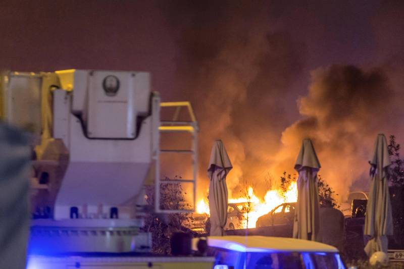DUBAI. UNITED ARAB EMIRATES, 04 AUGUST 2017. A massive fire rips through The Marina Torch tower's southern corner. Cars burn in an adjacent informal parking lot due to the flaming debris falling from the building. (Photo: Antonie Robertson) Journalist: None. Section: National.
