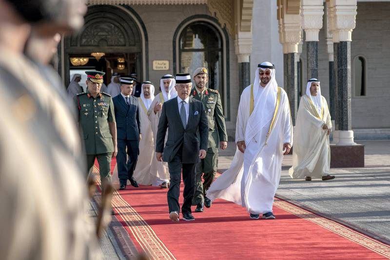 ABU DHABI, UNITED ARAB EMIRATES - June 14, 2019: HH Sheikh Mohamed bin Zayed Al Nahyan, Crown Prince of Abu Dhabi and Deputy Supreme Commander of the UAE Armed Forces (center R) bids farewell to HM King Sultan Abdullah Sultan Ahmad Shah of Malaysia (center L), at the Presidential Airport.  ( Hamad Al Kaabi / Ministry of Presidential Affairs ) ---