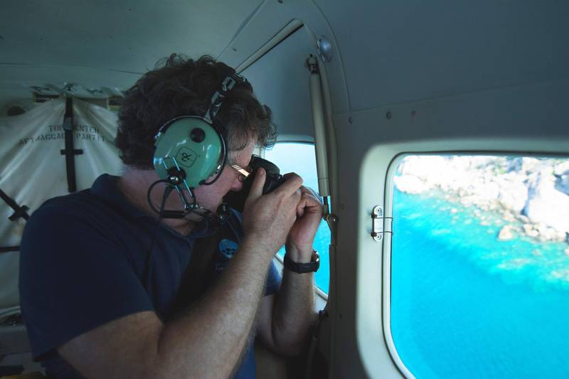 """This undated handout photo received on April 6, 2020 from the ARC Centre of Excellence for Coral Reef Studies at James Cook University, shows professor Terry Hughes conducting an   aerial survey of coral bleaching on the Great Barrier Reef. Australia's Great Barrier Reef has suffered its most widespread coral bleaching on record, scientists said on April 7, 2020 in a dire warning about the threat posed by climate change to the world's largest living organism. James Cook University professor Terry Hughes said a comprehensive survey last month found record sea temperatures had caused the third mass bleaching of the 2,300-kilometre (1,400-mile) reef system in just five years.  - TO BE USED EXCLUSIVELY FOR AFP STORY AUSTRALIA-ENVIRONMENT-CLIMATE-REEF RESTRICTED TO EDITORIAL USE - MANDATORY CREDIT """"AFP PHOTO / JAMES COOK UNIVERSITY"""" - NO MARKETING NO ADVERTISING CAMPAIGNS - DISTRIBUTED AS A SERVICE TO CLIENTS - NO ARCHIVE   / AFP / JAMES COOK UNIVERSITY AUSTRALIA / Handout / TO BE USED EXCLUSIVELY FOR AFP STORY AUSTRALIA-ENVIRONMENT-CLIMATE-REEF RESTRICTED TO EDITORIAL USE - MANDATORY CREDIT """"AFP PHOTO / JAMES COOK UNIVERSITY"""" - NO MARKETING NO ADVERTISING CAMPAIGNS - DISTRIBUTED AS A SERVICE TO CLIENTS - NO ARCHIVE"""
