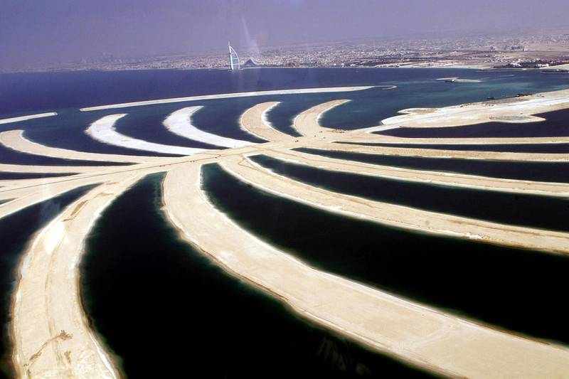 An aerial view shows the 17 fronds of the palm tree-shaped resort island on land reclaimed from the sea that will be visible from the moon, south of Dubai 17 November 2003. The Gulf emirate unveiled plans to build the resort which will include 2,000 villas, up to 40 luxury hotels, shopping complexes, cinemas and the Middle East's first marine park. With its oil resources running out, Dubai has launched a multi-billion dollar tourism drive in an effort to establish itself as the gulf's leisure hub.   AFP PHOTO/Rabih MOGHRABI (Photo by RABIH MOGHRABI / AFP)