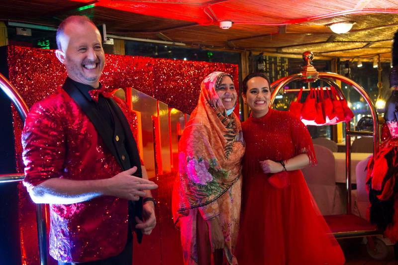 Dubai, United Arab Emirates - Richard the man behind the Big Ticket draw with Bouchra Yamani welcoming winners at the gathering of of Abu Dhabi Big Ticket winners at Alexandra Dhow Cruise, Dubai Marina.  Leslie Pableo for The National for Sarwat Nasir's story