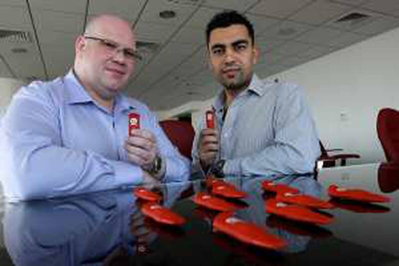 DUBAI, UNITED ARAB EMIRATES, Feb 22: Left to Right- David McKern, Chief Marketing Officer and Ahmad Zahran Chief Executive Officer of Infinitec with ÔInfinitÕ memory sticks at their office in the Liwa Heights tower in Jumeirah Lake Towers Dubai. (Pawan Singh / The National) For News.