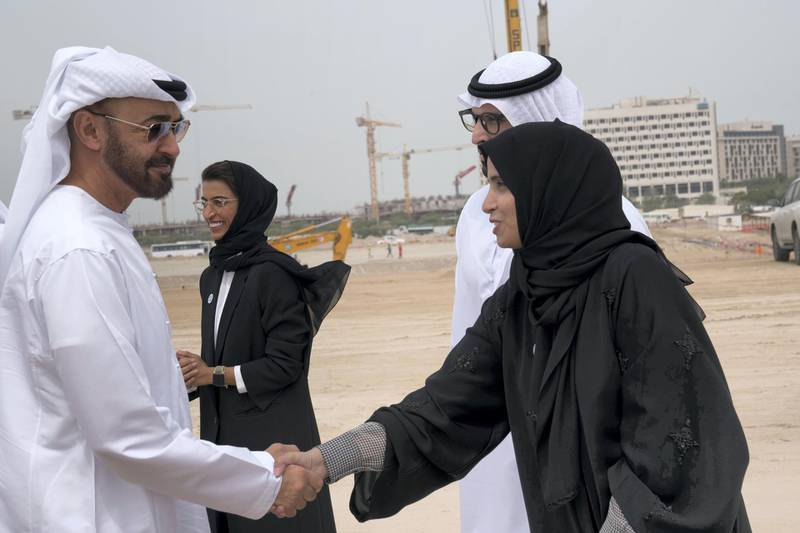 YAS ISLAND, ABU DHABI, UNITED ARAB EMIRATES - March 01, 2018: HH Sheikh Mohamed bin Zayed Al Nahyan, Crown Prince of Abu Dhabi and Deputy Supreme Commander of the UAE Armed Forces (L), greets HE Maryam Eid Al Mheiri, CEO of Media Zone Authority & and twofour54 (R), during the inspection of the urban development and tourism projects, at Yas Bay. Seen with HE Mohamed Khalifa Al Mubarak, Chairman of the Department of Culture and Tourism and Abu Dhabi Executive Council Member (2nd R) and HE Noura Mohamed Al Kaabi, UAE Minister of Culture and Knowledge Development (3rd R).  ( Mohamed Al Hammadi / Crown Prince Court - Abu Dhabi ) ---