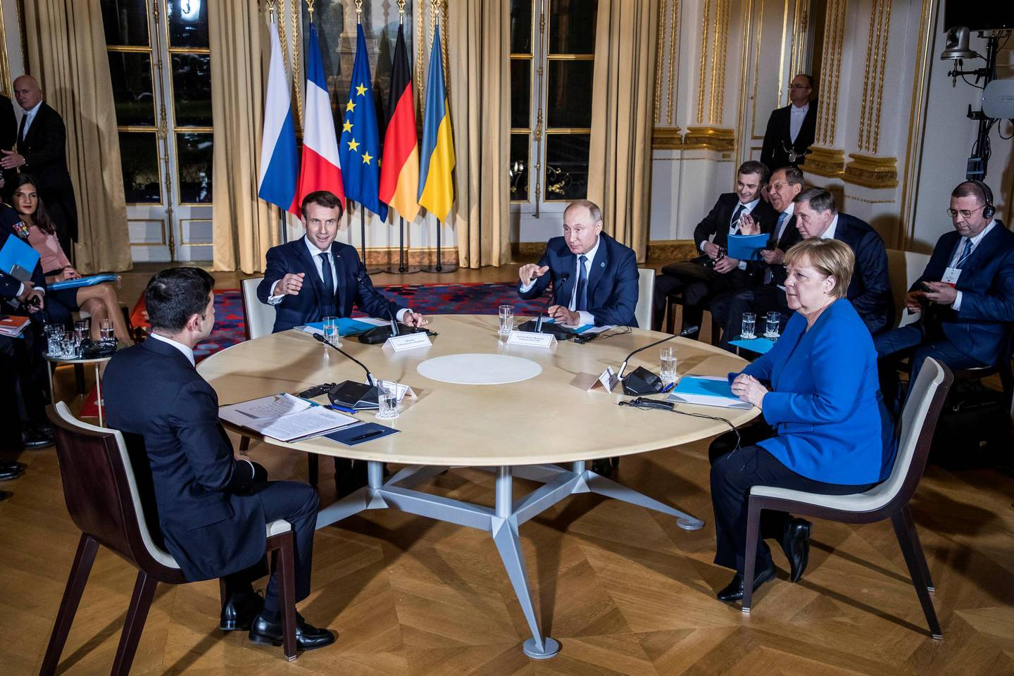 Ukrainian President Volodymyr Zelenskiy, German Chancellor Angela Merkel, French President Emmanuel Macron and Russian President Vladimir Putin attend a working session during a summit on the conflict in Ukraine at the Elysee Palace in Paris, France December 9, 2019. Christophe Petit Tesson/Pool via REUTERS