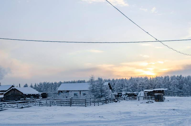2CAC6FY Winter sunset in one of the coldest places on earth, in the village Oymchkon in the Russian North. Alamy