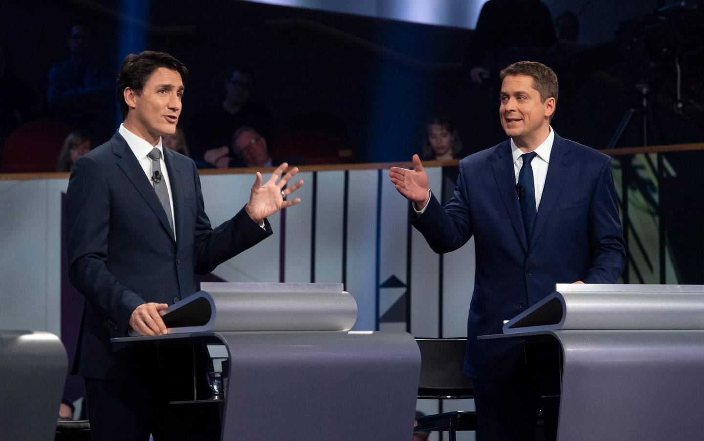 epa07911660 Canadian Prime Minister and Liberal leader Justin Trudeau (L) and Conservative leader Andrew Scheer (R) take part in a federal political leaders debate in Gatineau, Quebec, Canada, 10 October 2019. Canadians will vote in the country's 43rd general election on 21 October 2019.  EPA/ADRIAN WYLD / POOL