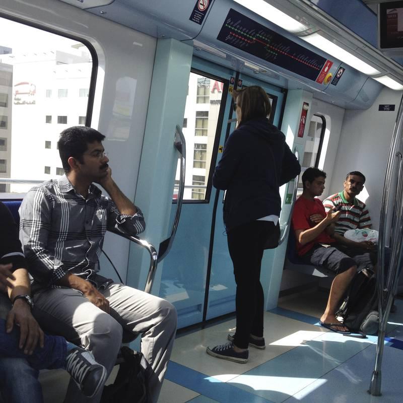 DUBAI, UAE. April 30, 2014 - Passengers ride the Dubai metro. The National takes the Dubai Metro from Ibn Battuta station to Rashidiya station in Dubai, April 30, 2014. (Photos by: Sarah Dea/The National, Story by: Martin Croucher, News)