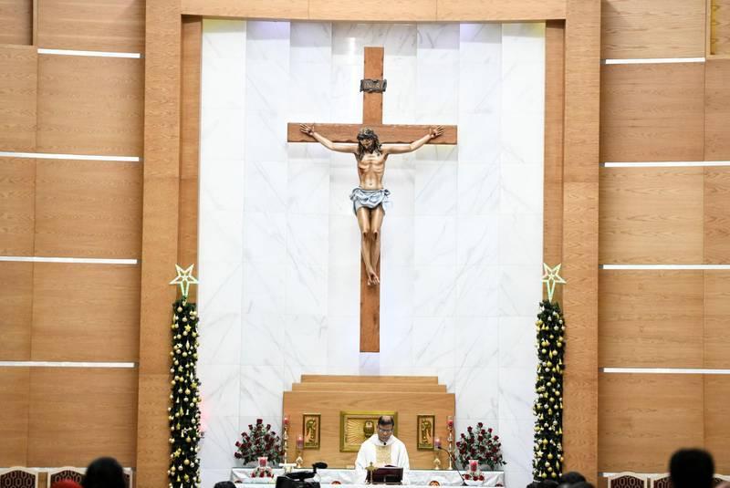 Abu Dhabi, United Arab Emirates - Father Cardoza conducts midnight mass at St. PaulÕs Catholic Church in Mussafah. Khushnum Bhandari for The National