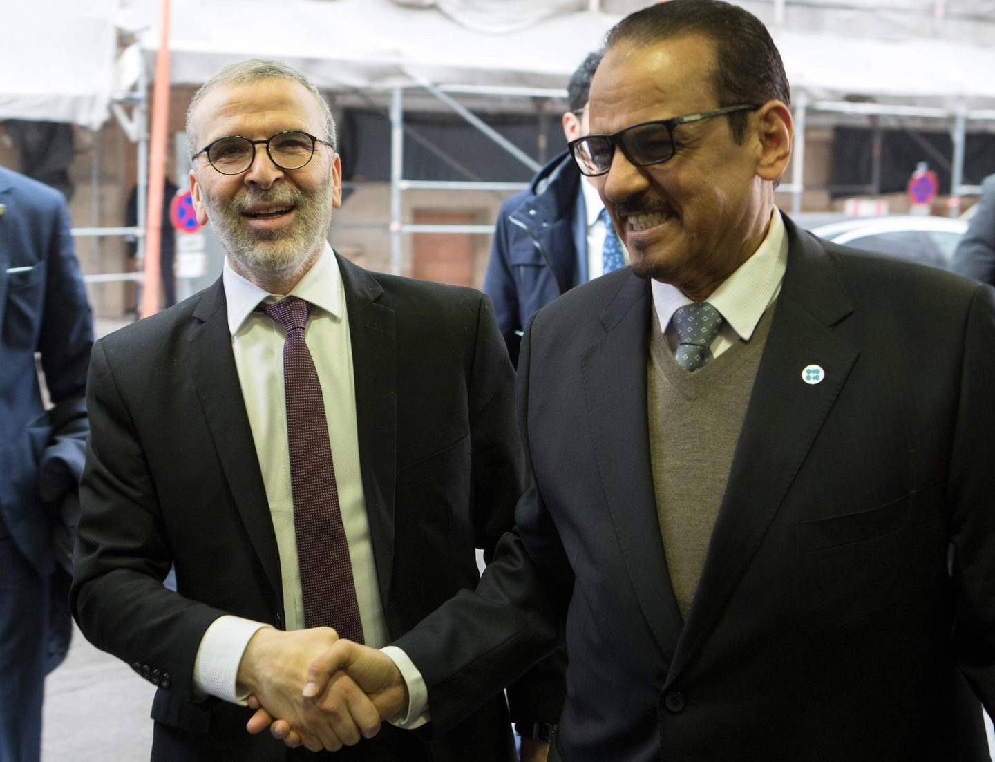 Libya's Mustafa Sanalla, Chairman of the National Oil Corporation (L) arrives for the 178th meeting of the Organization of Petroleum Exporting Countries (OPEC) in Vienna, Austria, on March 6, 2020.  All eyes are on Russia at the gathering of OPEC countries and their allies, with the cartel hoping to convince Moscow to back drastic production cuts to counter the effects of the coronavirus outbreak. / AFP / ALEX HALADA