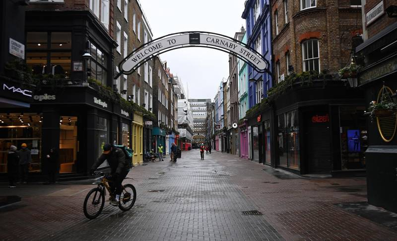 epa09016476 A deserted Carnaby in London, Britain, 16 February 2021. The UK government is preparing to announce the lifting of third UK lockdown. British Prime Minister Boris Johnson is set to deliver a speech 22 February to outline the easing of lockdown restrictions.  EPA/ANDY RAIN