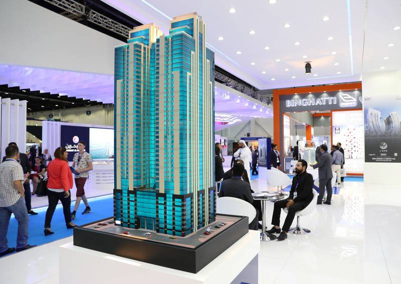 Dubai, United Arab Emirates - September 11th, 2017: Visitors at the Latifa Towers model at 16th addition of Cityscape Global. Monday, September 11th, 2017 at World Trade centre, Dubai.