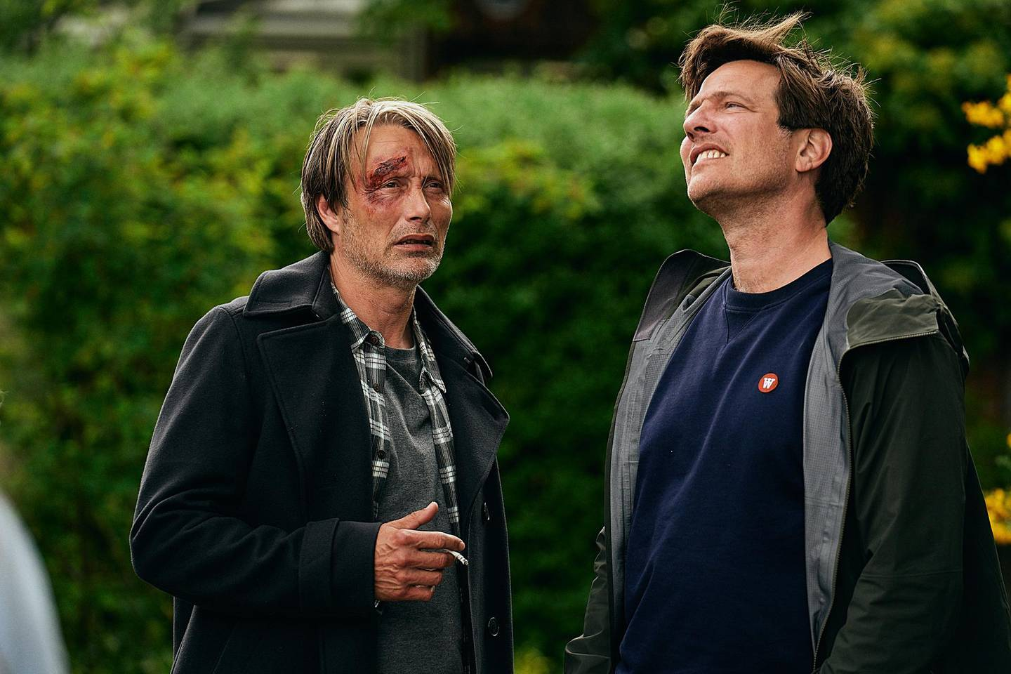 """This image released by Samuel Goldwyn Films shows Mads Mikkelsen, left, with director Thomas Vinterberg on the set of """"Another Round.""""  (Samuel Goldwyn Films via AP)"""