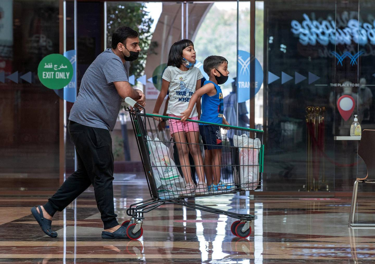 Abu Dhabi residents at the Khalidiyah Mall on June 19th, 2021. Abu Dhabi has temporarily suspended its green pass scheme while a technical fault with Al Hosn app is resolved. Victor Besa / The National.