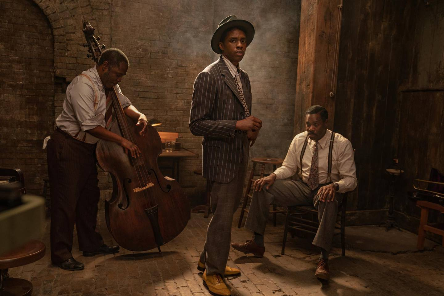 """This image released by Netflix shows Michael Potts, from left, Chadwick Boseman and Colman Domingo in """"Ma Rainey's Black Bottom."""" Boseman won the award for best actor in a motion picture drama at the Golden Globes on Sunday, Feb. 28, 2021. (David Lee/Netflix via AP)"""