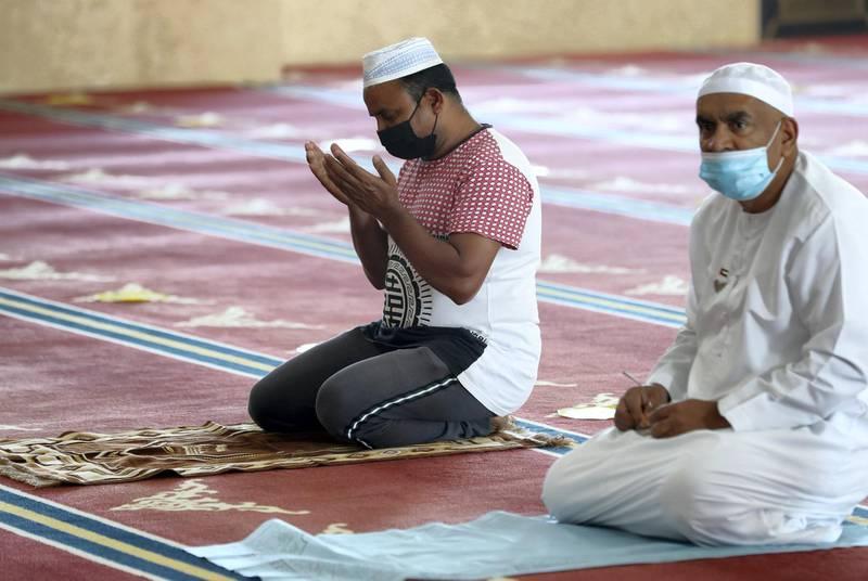 Dubai, United Arab Emirates - December 03, 2020: People pray at Al Farooq Omar Bin Al Khattab Mosque. Thursday, December 3rd, 2020 in Dubai. Chris Whiteoak / The National