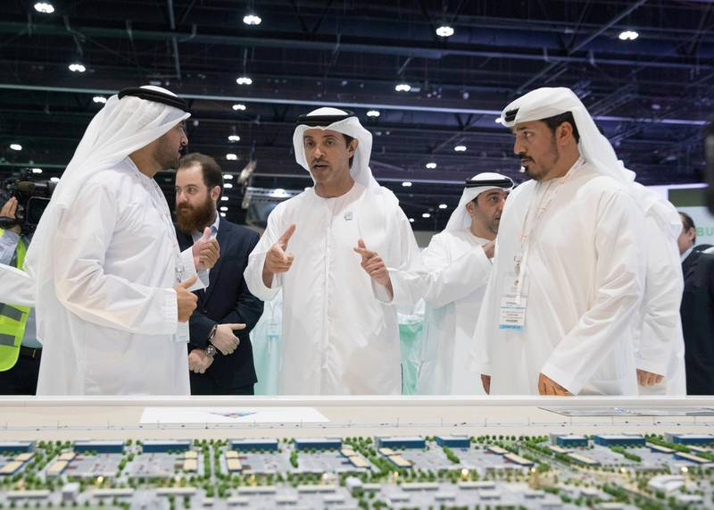 ABU DHABI, UNITED ARAB EMIRATES - April 16, 2019: HH Sheikh Hazza bin Zayed Al Nahyan, Vice Chairman of the Abu Dhabi Executive Council (C), attends the opening of Cityscape Abu Dhabi, at Abu Dhabi National Exhibition Centre (ADNEC). Seen with HE Falah Mohamed Al Ahbabi, Chairman of the Department of Urban Planning and Municipalities and Abu Dhabi Executive Council Member (L).  ( Mohammed Al Blooshi for Ministry of Presidential Affairs ) ---