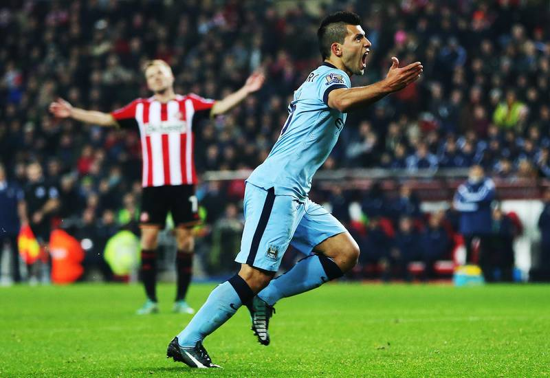 """Manchester City's Argentinian striker Sergio Aguero celebrates scoring their first goal during the English Premier League football match between Sunderland and Manchester City at The Stadium of Light in Sunderland, north east England on December 3, 2014.  AFP PHOTO / IAN MACNICOL  RESTRICTED TO EDITORIAL USE. No use with unauthorized audio, video, data, fixture lists, club/league logos or """"live"""" services. Online in-match use limited to 45 images, no video emulation. No use in betting, games or single club/league/player publications. (Photo by Ian MacNicol / AFP)"""
