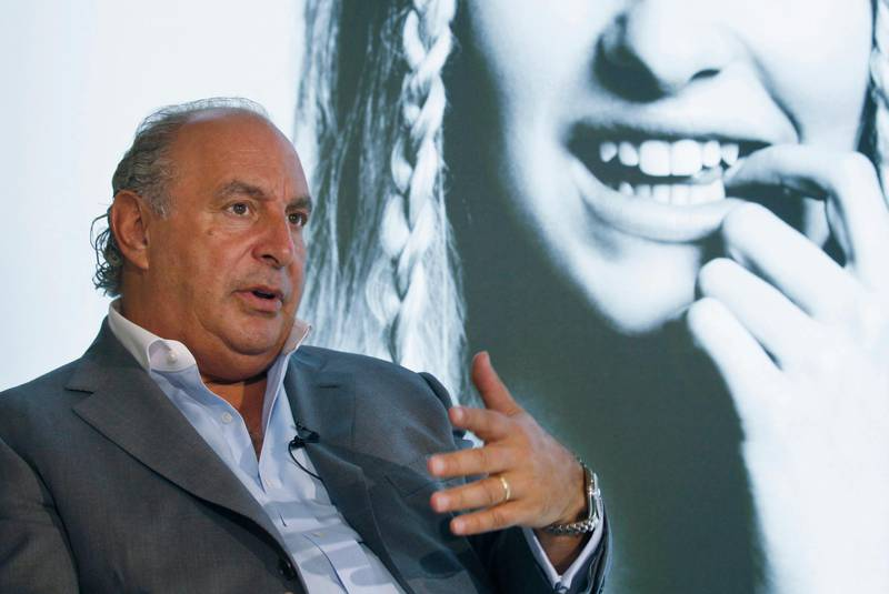 FILE - In this file photo dated Wednesday, June 5, 2013, Philip Green speaks during an interview at his new Topshop store in Hong Kong.  British politician Peter Hain has used British Parliament's free-speech guarantee to name the prominent businessman Philip Green, who according to Hain, is facing employee allegations of sexual harassment and racial abuse and previously secured a court order barring the media from revealing his identity. (AP Photo/Kin Cheung, FILE)