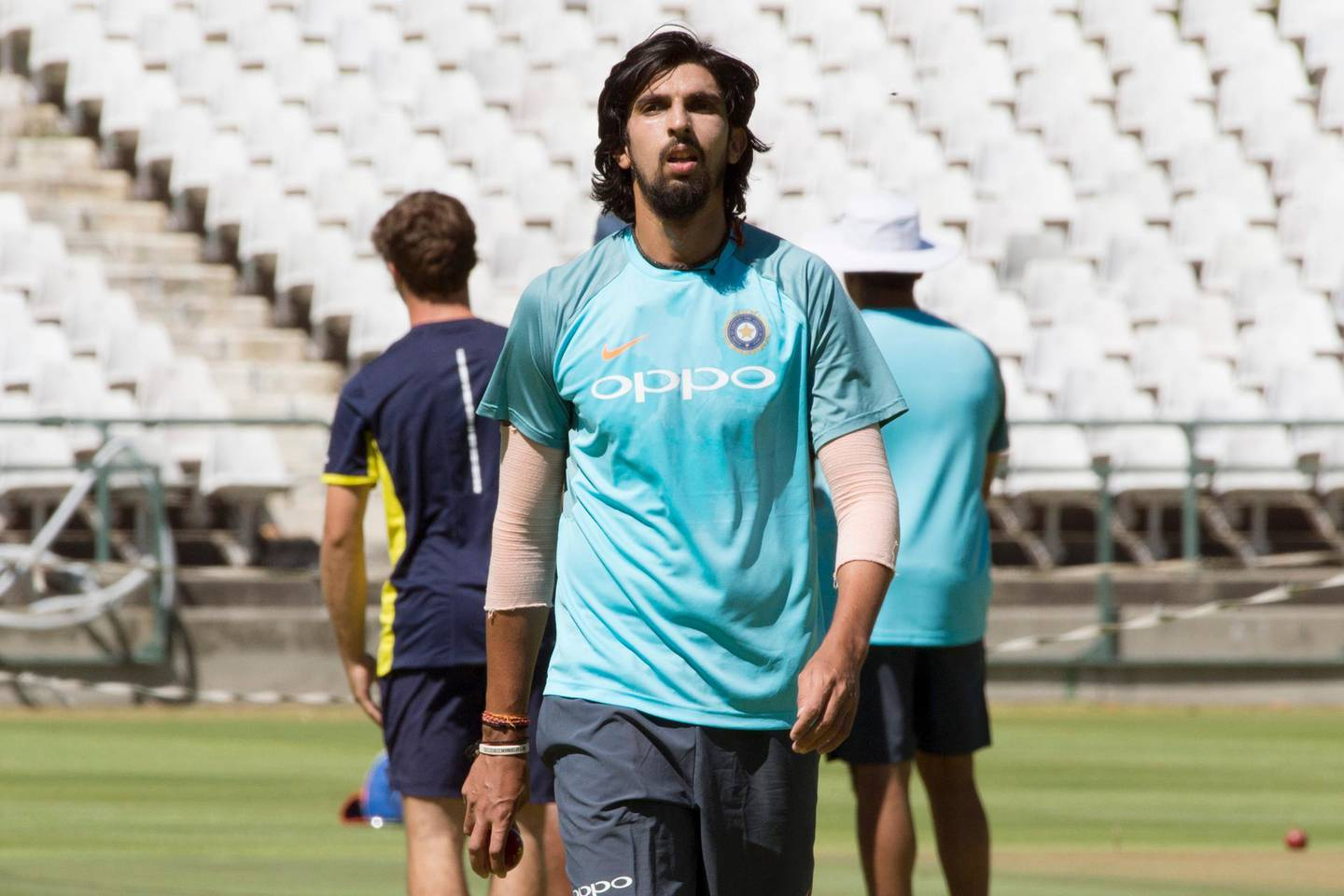 India's bowler Ishant Sharma, walks up the crease as he takes part in training session at the Newlands Cricket ground on January 3, 2018, in Cape Town, prior to the first of three cricket tests matches between South Africa and India. / AFP PHOTO / RODGER BOSCH