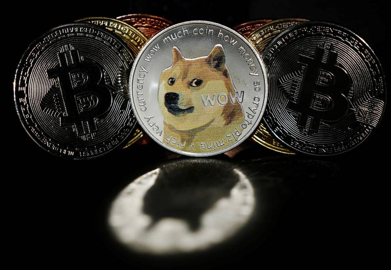 Representations of cryptocurrencies Bitcoin and Dogecoin are seen in this picture illustration taken June 7, 2021.   REUTERS/Edgar Su/Illustration