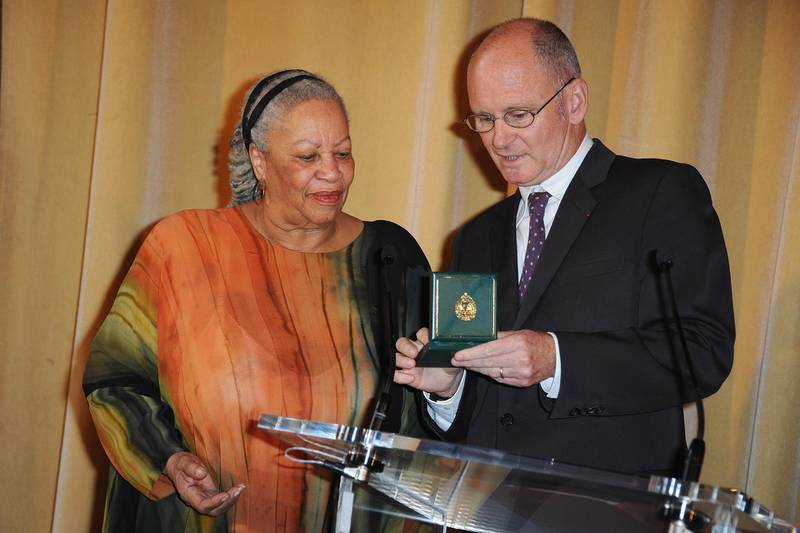 PARIS - NOVEMBER 04:  US Author and Nobel Prize in literature winner Toni Morrison (L) receives the Honor Medal of The City of Paris (Grand Vermeil) from Christophe Girard (R) at Mairie de Paris on November 4, 2010 in Paris, France.  (Photo by Francois Durand/Getty Images)