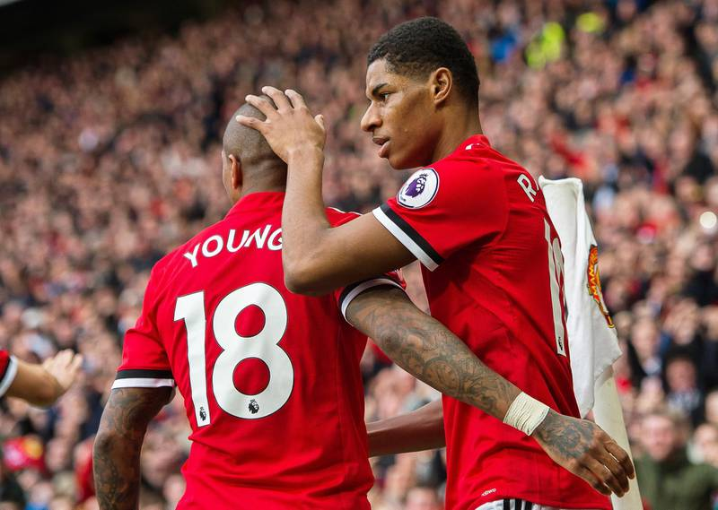 epa06593988 Manchester United's Marcus Rashford (R) celebrates with his teammate Ashley Young (L) after scoring the opening goal during the English Premier League soccer match between Manchester United and Liverpool FC at the Old Trafford in Manchester, Britain, 10 March 2018.  EPA/PETER POWELL EDITORIAL USE ONLY. No use with unauthorized audio, video, data, fixture lists, club/league logos or 'live' services. Online in-match use limited to 75 images, no video emulation. No use in betting, games or single club/league/player publications