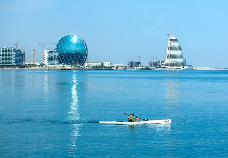 Abu Dhabi, UAE, April 30, 2021. Recreational watercraft is a common sight on weekends along the Al Raha Creek, Aldar Headquarters area.. Victor Besa / The National.