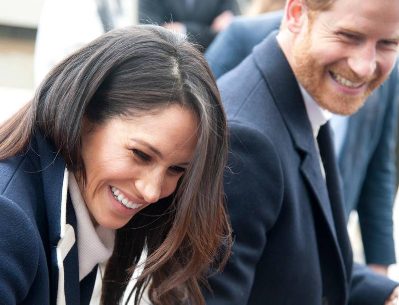 """FILE - In this file photo dated Thursday March 8, 2018, Britain's Prince Harry and his fiancee Meghan Markle arrive for an event for young women, as part of International Women's Day in Birmingham, central England. Kensington Palace said Monday May 14, 2018, that Britain's Prince Harry and Meghan Markle are requesting """"understanding and respect"""" for Markle's father after a celebrity news site reported he would not be coming to the royal wedding to walk his daughter down the aisle. (AP Photo/Rui Vieira, FILE)"""
