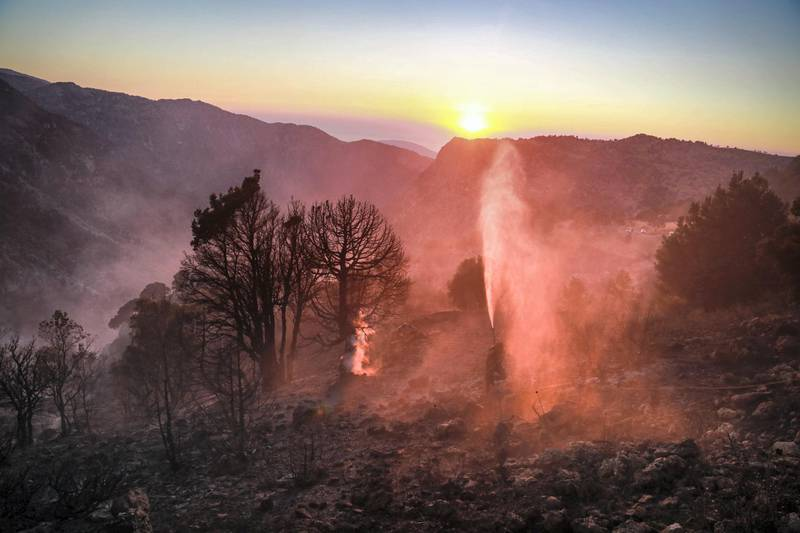 Smoke rises from a forest in Jird Meshmesh, in Lebanon's Akkar region on Aug. 24, 2020